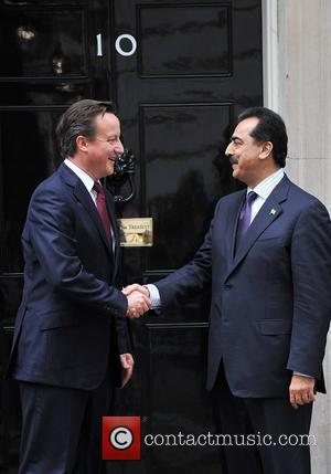 The Prime Minister of Pakistan Yousaf Raza Gillani is greeted by British Prime Minister David Cameron at 10 Downing Street....
