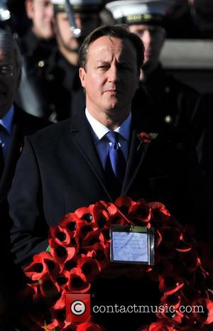 David Cameron Remembrance Sunday commemorating sacrifices of the armed forces held at the Cenotaph. London, England - 11.11.12