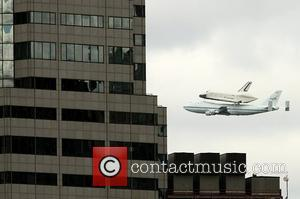 The space shuttle Enterprise flies over New York City strapped on a NASA plane on the way to JFK airport...