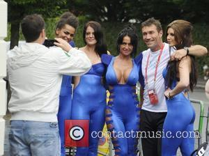 Pat Cash poses for a photograph with four catsuit clad ladies from 'Tantric Blue Gentleman's Club' as they distribute flyers...
