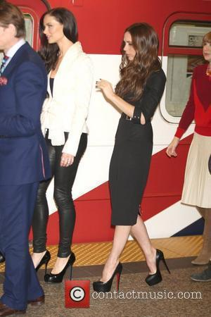 Georgina Chapman, Victoria Beckham Fashion leaders launch the inaugural run of a Union Jack flag covered subway train in conjunction...