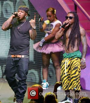 Birdman and Lil Wayne performing live on the Nicki Minaj Tour at James L Knight Center  Miami, Florida -24.07.12
