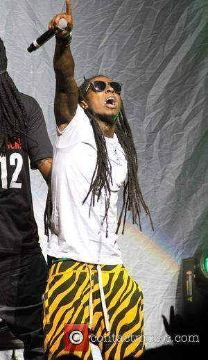 Lil' Wayne performs during the 'Pink Friday Tour' at the James L. Knight Center  Miami, Florida - 24.07.12