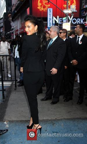 Nicole Scherzinger attends a photocall at the NASDAQ MarketSite in Times Square for 'Men in Black 3' New York City,...