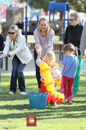 Nicole Sullivan enjoys some family time with her sons at a park in West Hollywood West Hollywood, California - 11.02.12
