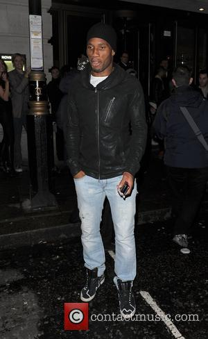 Chelsea FC player Didier Drogba leaving Novikov restaurant. London, England - 05.05.12