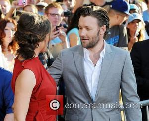 Joel Edgerton and Jennifer Garner at the World Premiere of 'The Odd Life of Timothy Green' at El Capitan Theater...