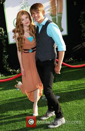 Katherine McNamara and Joel Courtney at the World Premiere of 'The Odd Life of Timothy Green' at El Capitan Theater...