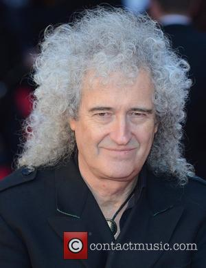 Brian May Carries Lion For Documentary