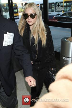 Ashley Olsen  arrive at Los Angeles International Airport and walks bare foot through the security check Los Angeles, California-...