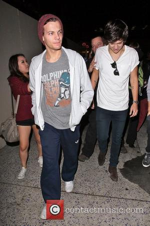 Louis Tomlinson and Harry Styles,  of One Direction seen arriving at LAX airport. Los Angeles California - 06.11.12