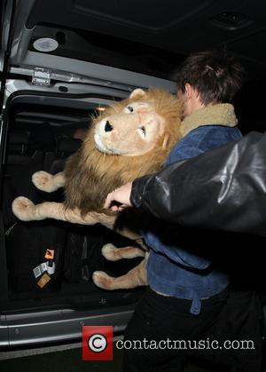 One Direction arrive at a manic Heathrow Terminal 5 holding giant animal soft toys  Featuring: Louis Tomlinson