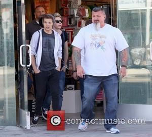 Liam Payne and Niall Horan Members of One Direction shopping at Urban Outfitters on Melrose Avenue with two bodyguards Los...