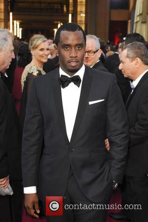 Sean Combs Used As A Prop In Basketball Competition