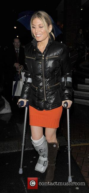 Hofit Golan leaving the Paige Denim cocktail party on crutches, with her leg in a cast. London, England - 01.12.11