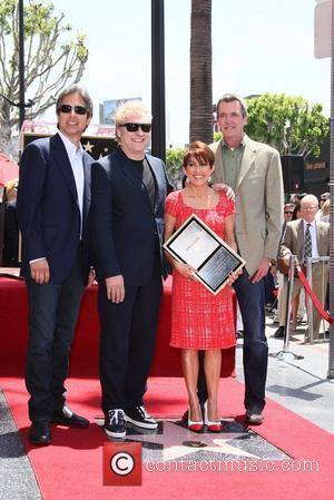 Actors Ray Romano (l-r), David Hunt, Patricia Heaton and Neil Flynn attend the ceremony honoring Patricia Heaton with a new...