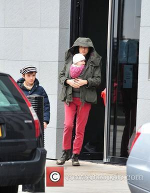 Jennifer Connelly and son Paul Bettany and Jennifer Connelly out and about with their children in Liverpool. Paul has been...