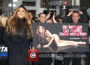Wendy Williams unveils her new nude PETA campaign in Times Square saying she'd rather go naked than wear fur New...