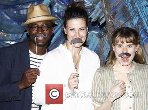 Taye Diggs and Idina Menzel pose with Celia Keenan-Bolger Celebrities visit the cast of the Broadway play 'Peter and the...