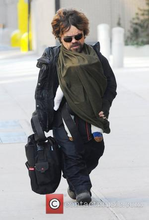 Peter Dinklage carrying his baby daughter as he arrives at his Manhattan Hotel  New York City, USA - 13.02.12