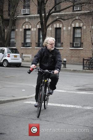 Philip Seymour Hoffman Philip Seymour Hoffman riding his bike while holding a bottle of Coca Cola in New York City...