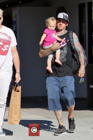 Carey Hart and daughter Willow Sage Hart Carey Hart carries his baby daughter as they leave 98% Angel clothing boutique...