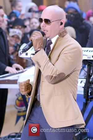 Pitbull performs  live at the