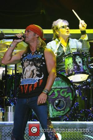 Bret Michaels and Rikki Rockett  Poison performs during the Rock of Ages Tour 2012 at the Bank Atlantic Center...