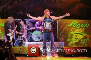 C.C. DeVille, Rikki Rockett, Bret Michaels and Bobby Dall  Poison performs during the Rock of Ages Tour 2012 at...