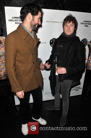 Tom Ellis; Tom Meighan Rock stars and celebrities attend Liam Gallagher's 'Pretty Green London Collections: Men's Autumn/Winter 2013 Launch' held...