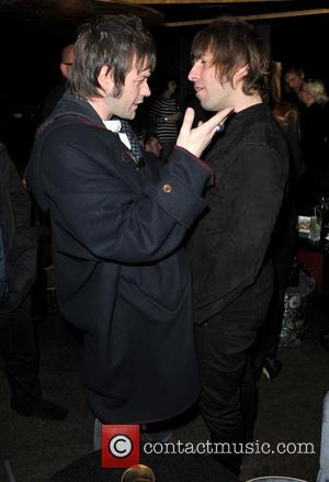 Tom Meighan and Liam Gallagher