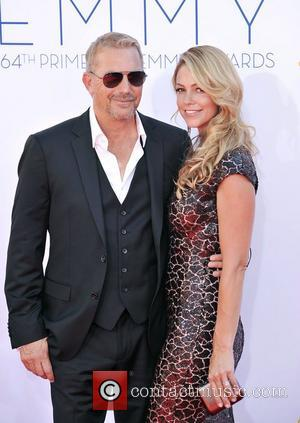 Kevin Costner, Christine Baumgartner  64th Annual Primetime Emmy Awards, held at Nokia Theatre L.A. Live - Arrivals Los Angeles,...