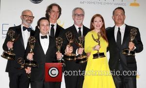 Danny Strong, Jay Roach, Gary Goetzman, Julianne Moore and Tom Hanks