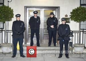 Police officers guard the entrance to King Edward VII Hospital in Central London where The Duchess of Cambridge has been...