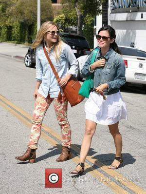 Rachel Bilson and Kristen Bell  seen leaving a gifting suite in Beverly Hills  Los Angeles, California - 15.06.12