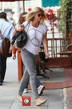 Rachel Hunter out and about in Beverly Hills walking in flat gold shoes and wearing a CND (Campaign for Nuclear...