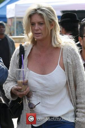 A casually dressed Rachel Hunter spends the afternoon walking around a local flea market with friends Los Angeles, California -...