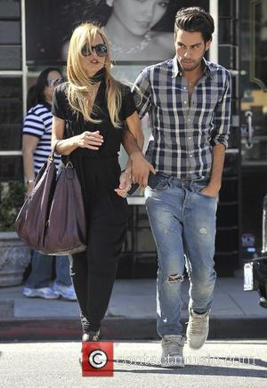 Rachel Zoe  and her assistant walking arm in arm in Beverly Hills  Los Angeles, California - 28.06.12