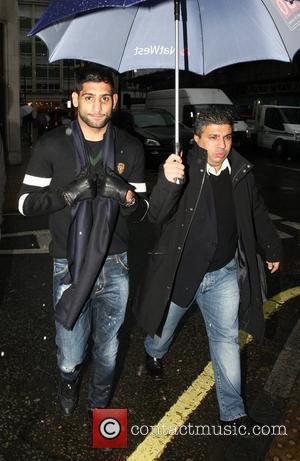 Amir Khan leaves the BBC Radio 1 studios London, England - 16.12.11
