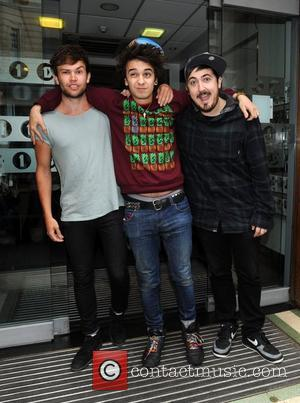 Ashley Horne, Stefan Abingdon and Dru Wakely of The Midnight Beast at the BBC Radio 1 studios London, England -...