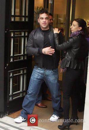 Robbie Williams leaving the BBC Radio 2 studios London, England - 22.10.12