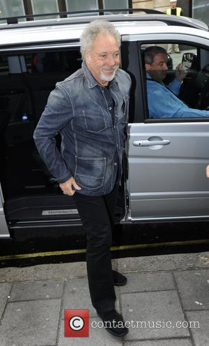 Tom Jones arrives at the BBC Radio 1 studios, to promote the television show 'The Voice', on which he is...