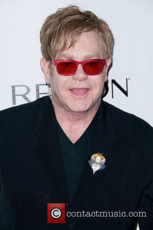 Elton John and Jenna Dewan