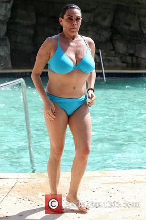 Renee Graziano, start of VH1's 'Mob Wives,' is seen in a two piece bikini while vacationing poolside at the Seminole...