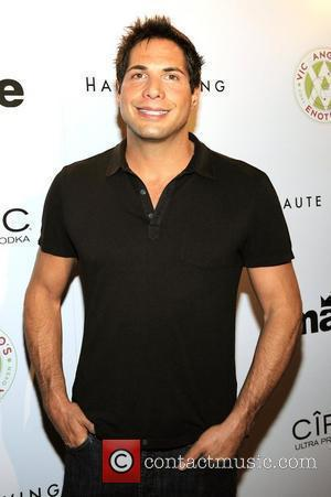 Joe Francis Handcuffed After Traffic Accident