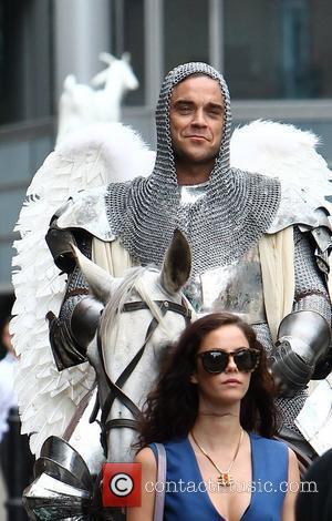 Kaya Scodelario and Robbie Williams on the set of his new music video 'Vertigo' London, England - 17.08.12
