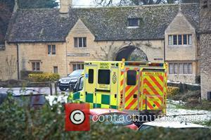 An ambulance parked outside the home of Robin Gibb. The BeeGee is reportedly recovering well after responding to treatment for...