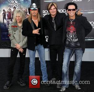 C.C. Deville, Bret Michaels, Rikki Rockett, and Bobby Dall of rock band Poison Premiere of Warner Bros. Pictures' Rock Of...