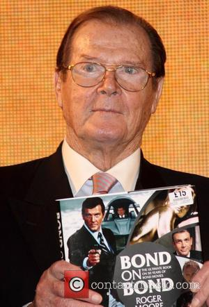 Sir Roger Moore signs copies of his new book 'Bond On Bond' at HMV Oxford Street London, England - 22.10.12