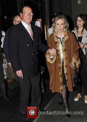 Sir Roger Moore and Kristina Tholstrup leaving Harrods in Knightsbridge together London, England - 11.10.12